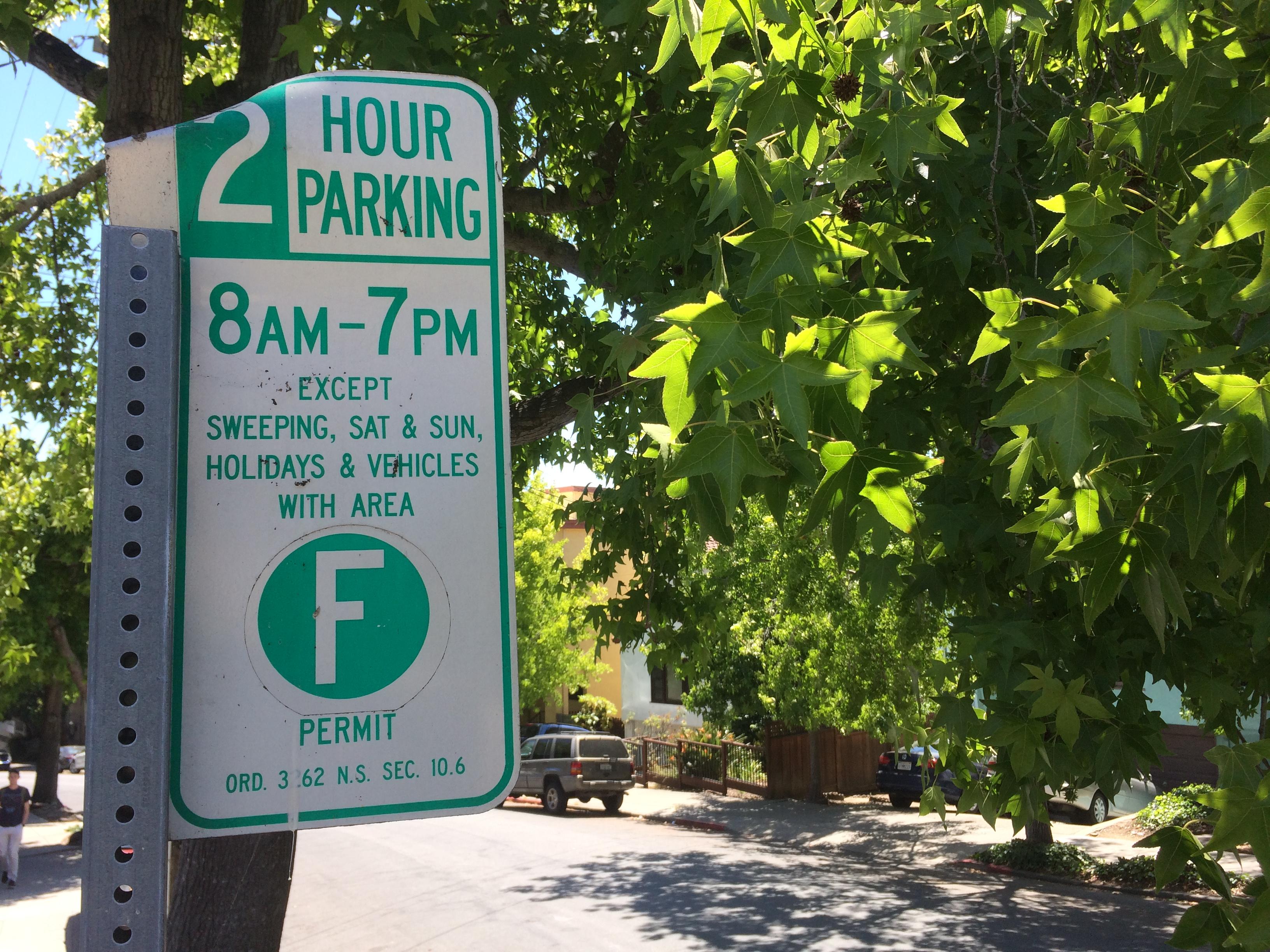Berkeley parking sign in trees.
