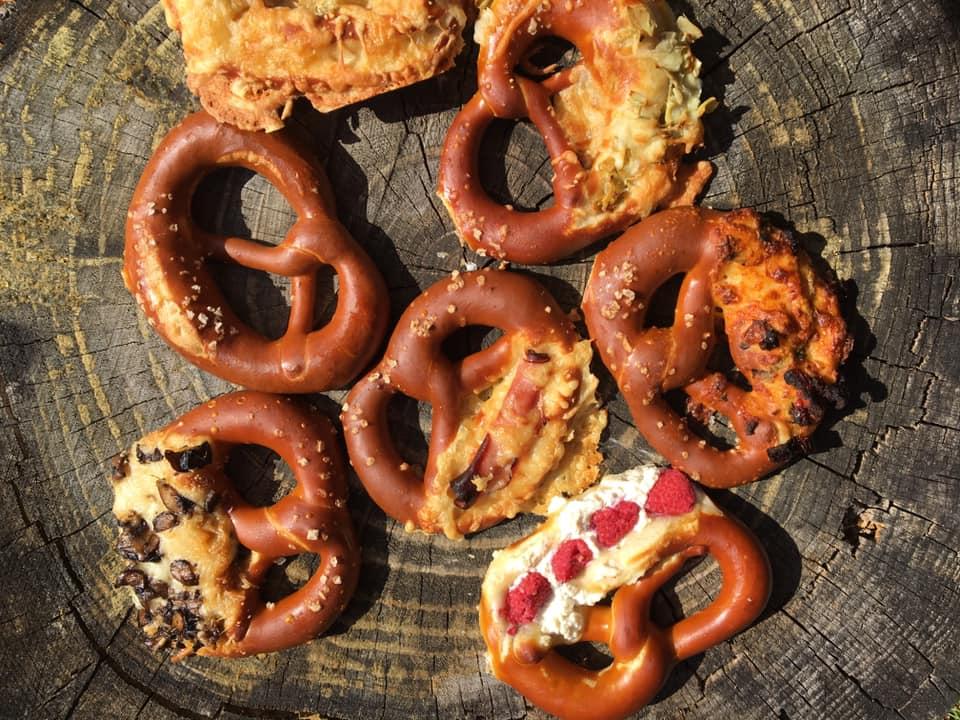 An assortment of Squabisch pretzels arranged on a tree stump.