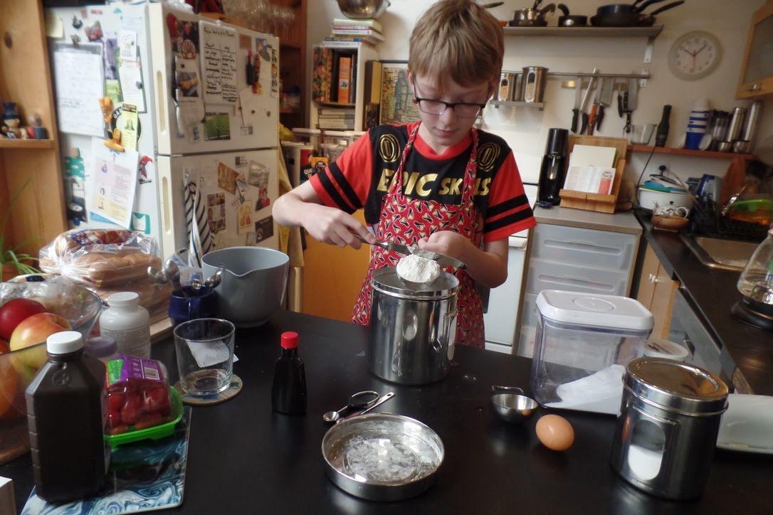 Leo Della Penna measures flour to bake cookies.