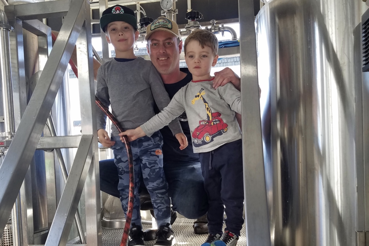 Ocean View Brew Works brewer Scott Davidson with his two sons. Photo courtesy of Scott Davidson