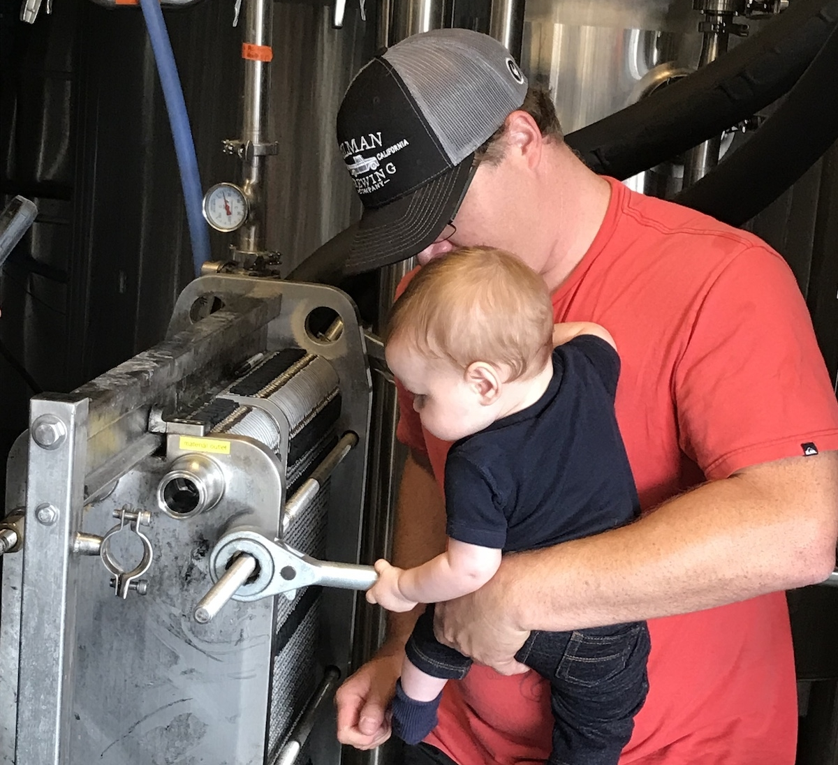Gilman Brewing Co. owner Sean Wells with his son. Photo courtesy Sean Wells