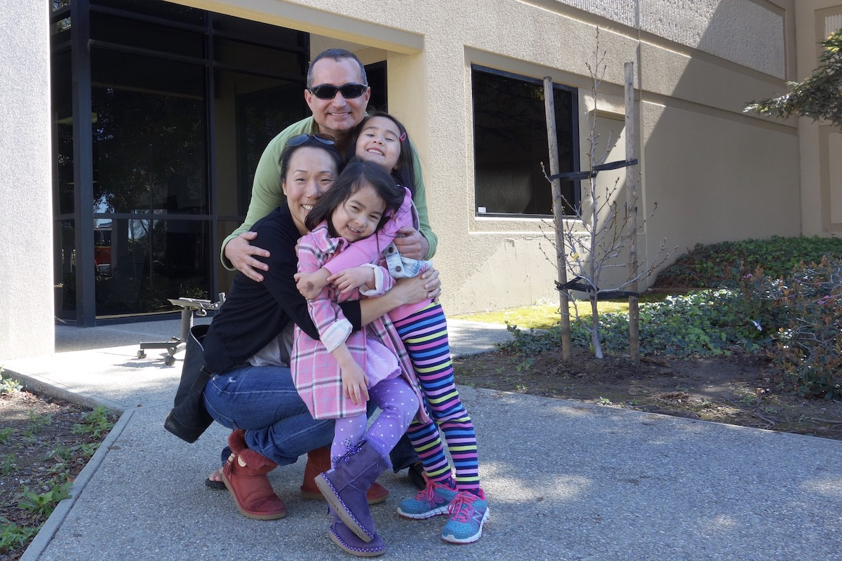 Brian Blackburn and family in front of Shadow Puppet Brewing. Photo courtesy of Brian Blackburn