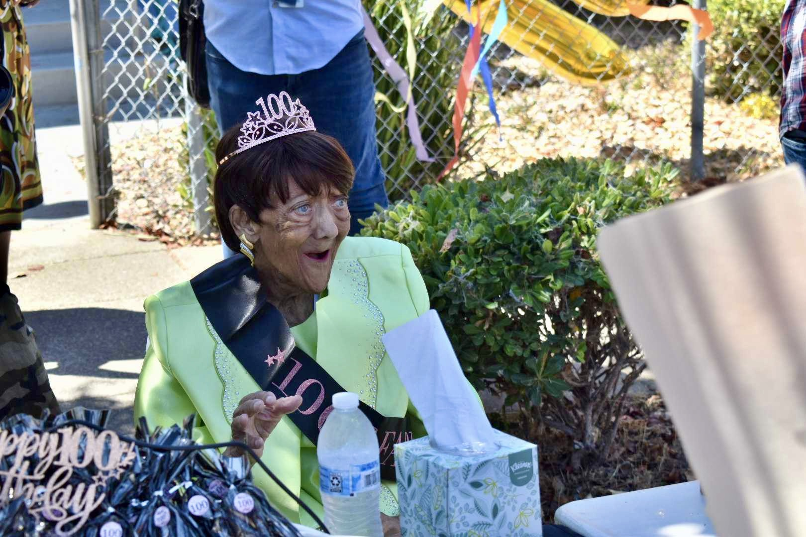 Eddie Mae Eddings reacts with a smile to the city proclamation for her birthday