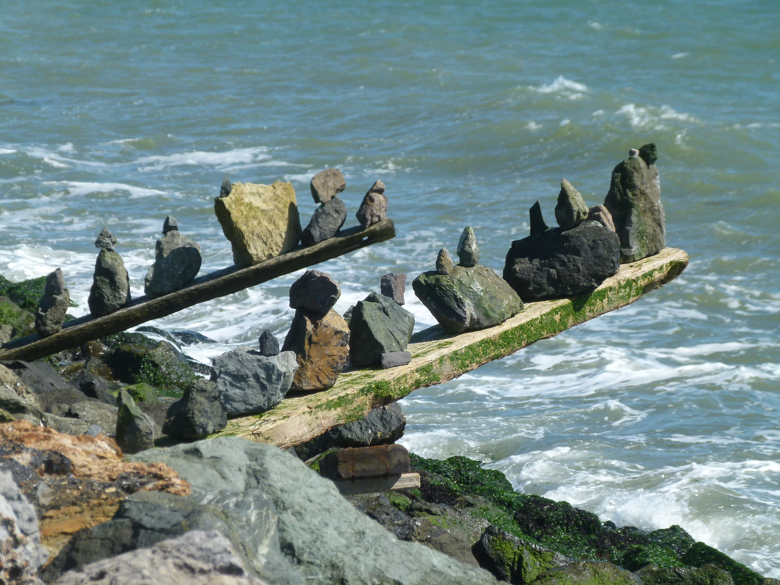 Two boards with rocks on them jutting out into SF Bay