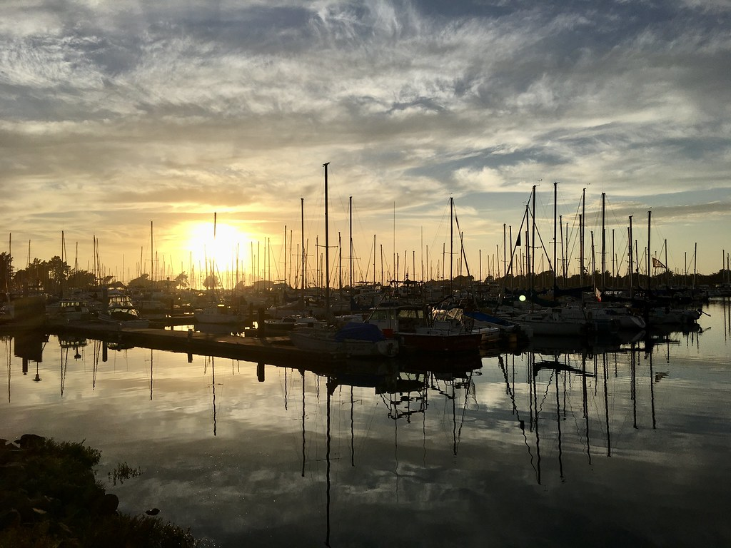 marina and sailboats set in front of sunset