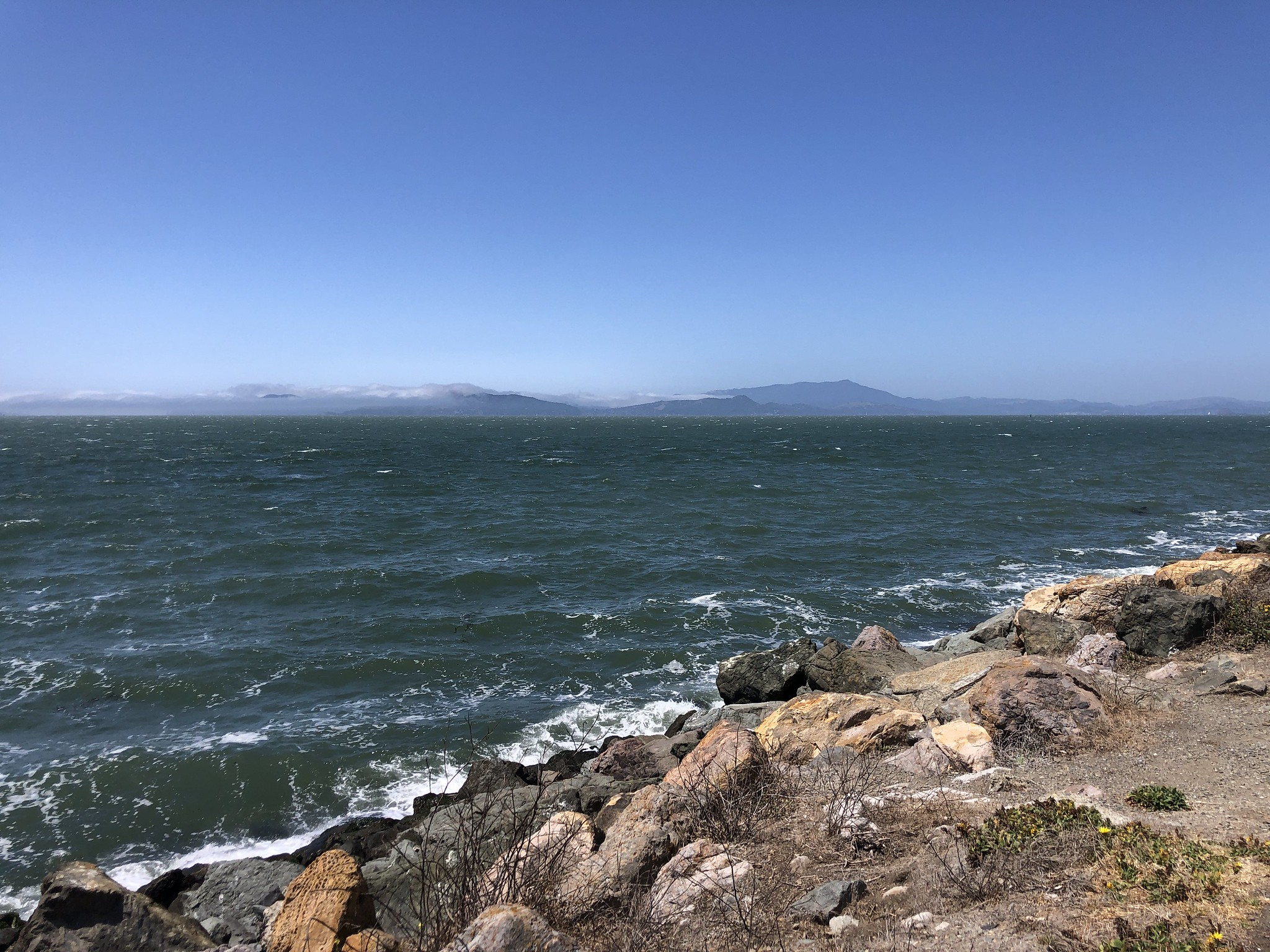 rocky shoreline and bay and swells