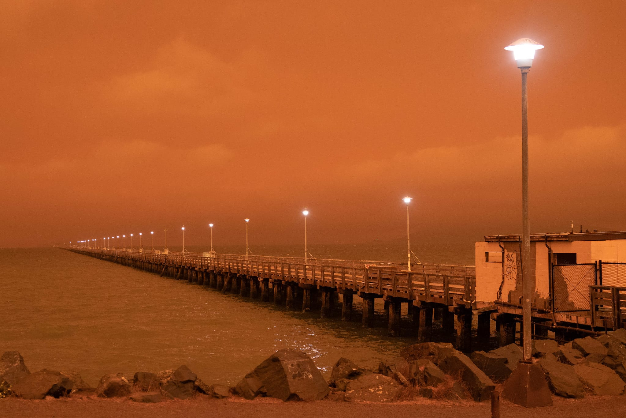 pier in strange orange light